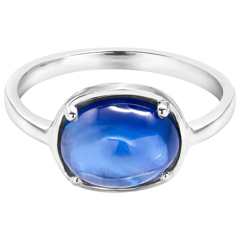 Eighteen karat white gold ring Ceylon cabochon sapphire weighing  4.25 carat   Sapphire measuring 10x8 millimeter                                                                       Ring size 6 In Stock Ring can be resized  New Ring Handmade in