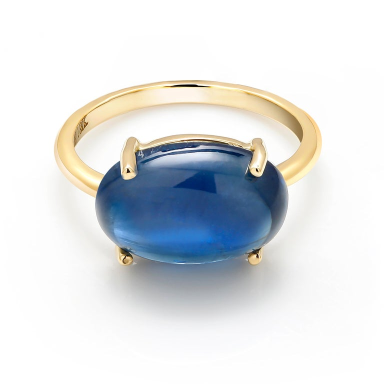 Eighteen karat yellow gold cocktail ring Ceylon cabochon sapphire weighing  9.16 carat   Sapphire measures 14x12 millimeter                                                                       Ring size 5 In Stock Ring can be resized  New
