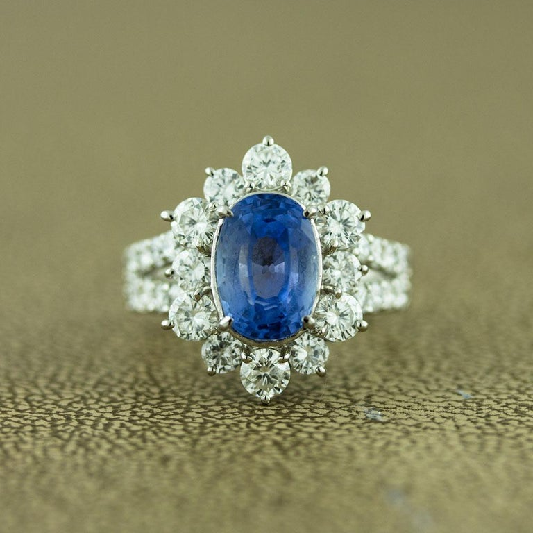 A rare unheated blue sapphire from Sri Lanka, formerly known as Ceylon, is set atop this special ring. It weighs 4.86 carats and is cut as an oval shape. It is surrounded by 1.83 carats or round brilliant cut diamonds which are set on the shoulders