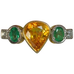 Ceylon Orange Sapphire Emerald and Diamond 18 Carat Gold Five-Stone Ring