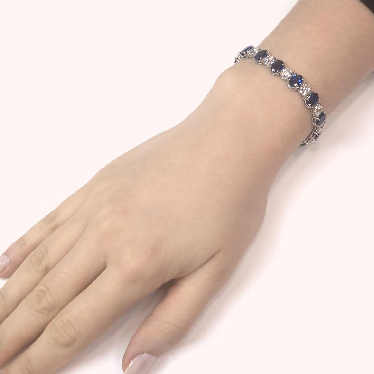 Retro inspired handcrafted platinum bracelet with blue oval Ceylon sapphires 19.44 ct.  Accented with white round diamonds 10.57 ct. Diamonds are natural in G-H Color Clarity VS. Width: 0.7 cm Height: 17.5 cm Weight: 35.4 g