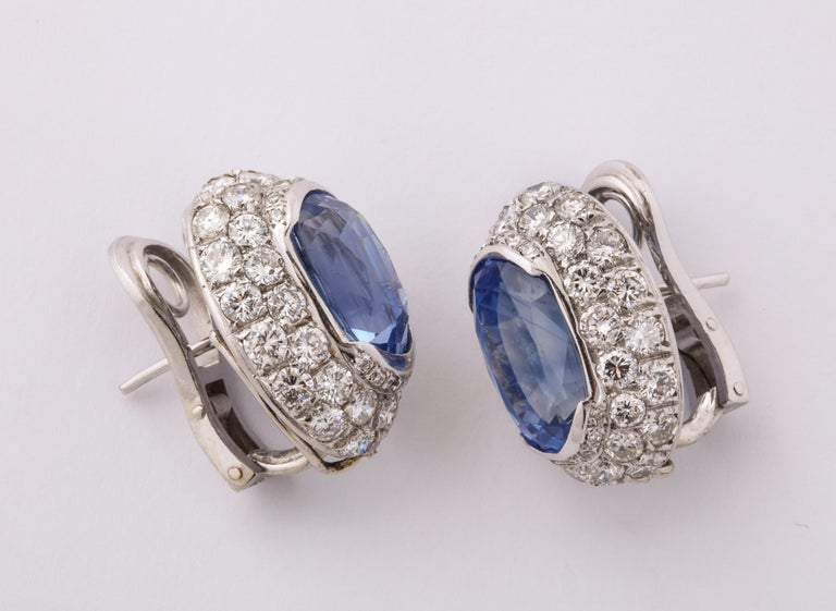 Ceylon Sapphire Diamond Platinum Earrings featuring 2 oval sapphires of approximately 6 carats total weight and 88 fine white full cut diamonds set in platinum. Clip on back allows for addition of a drop if desired.  The earrings are unmarked but
