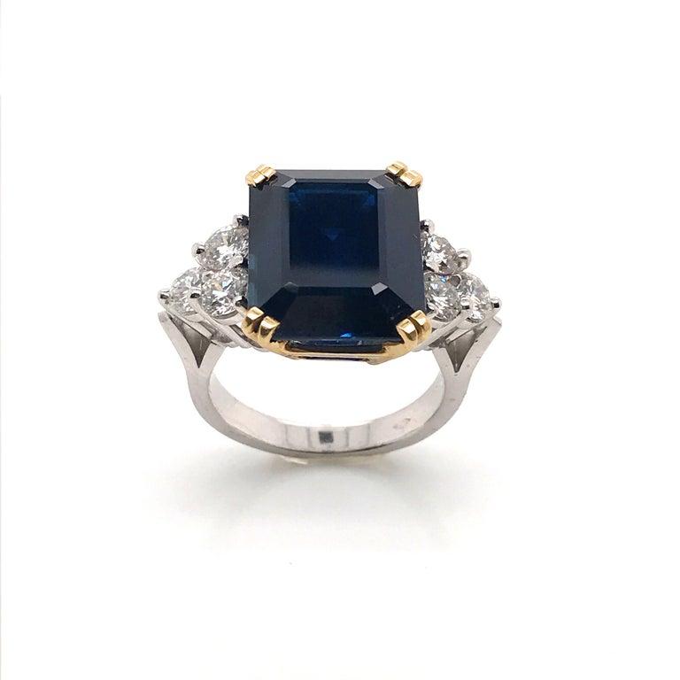 Ceylon Sapphire Diamonds Emerald size White and Yellow Gold Ring. Ceylon Sapphire Form Emerald 14,35 Carat 6 White Diamonds 1,62 Carat Color F/G White Gold 18 Carat Yellow Gold 18 Carat