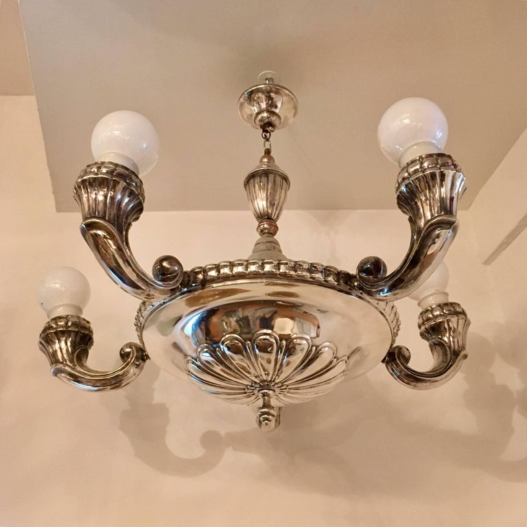 A 1920s silver plated five-arm chandelier made by the Swedish maker, CG Hallberg. Newly rewired.