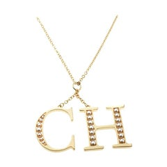 CH Carolina Herrera Faux Pearl Logo Charm Gold Tone Long Pendant Necklace