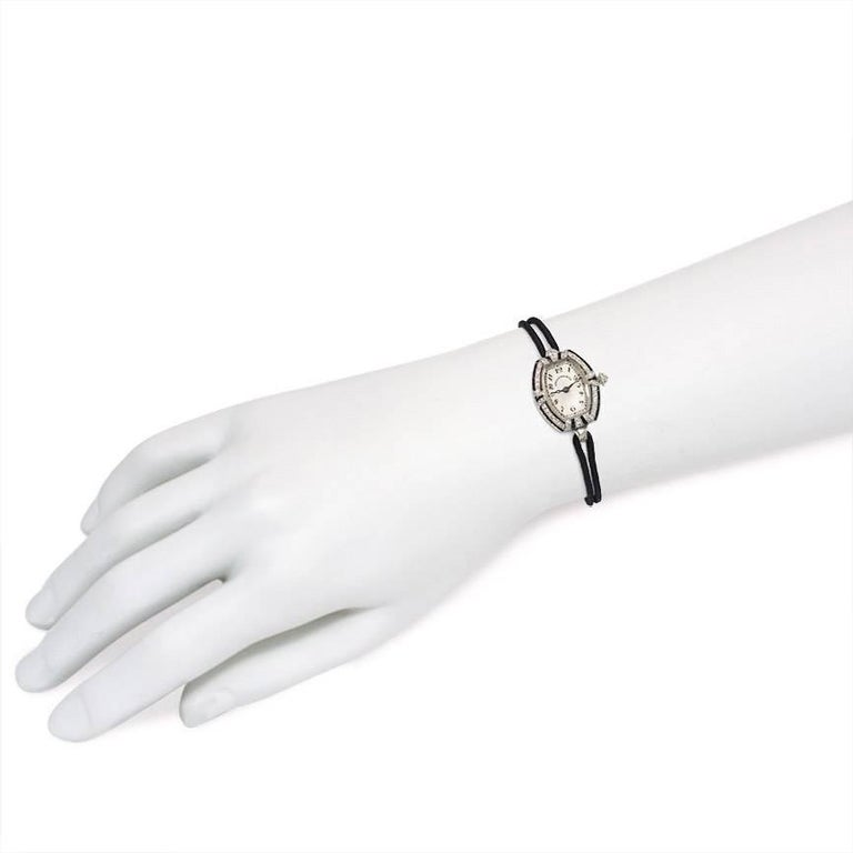 C.H. Meylan Lady's Platinum, Diamond and Onyx Art Deco Wristwatch In Excellent Condition For Sale In New York, NY