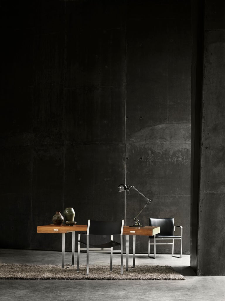 The CH111 chair designed by Hans J. Wegner is part of a series of significant furniture with a frame in flat stainless steel and seats and backs upholstered in leather. The chair's subtle strength and clean and simple lines are the essence of