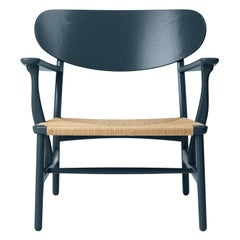 CH22 Lounge Chair in Oak / North Sea by Hans J. Wegner & Ilse Crawford