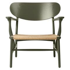 CH22 Lounge Chair in Oak / Seaweed by Hans J. Wegner & Ilse Crawford