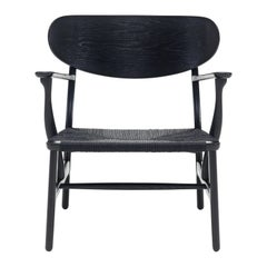 CH22 Lounge Chair in Wood with Black Papercord Seat by Hans J. Wegner