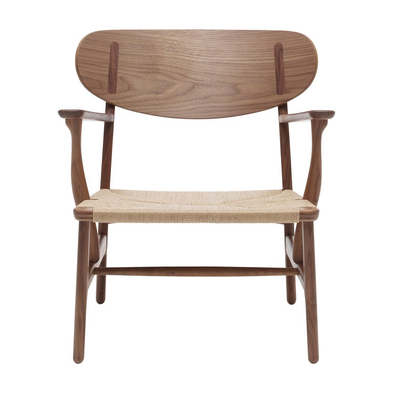 For Sale: Brown (Walnut Oil) CH22 Lounge Chair in Wood with Natural Papercord Seat by Hans J. Wegner