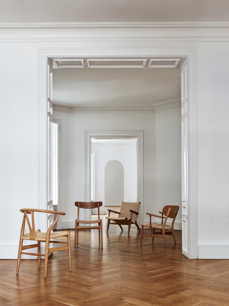 Contemporary CH23 Dining Chair in Wood Finishes with Black Papercord Seat by Hans J. Wegner For Sale
