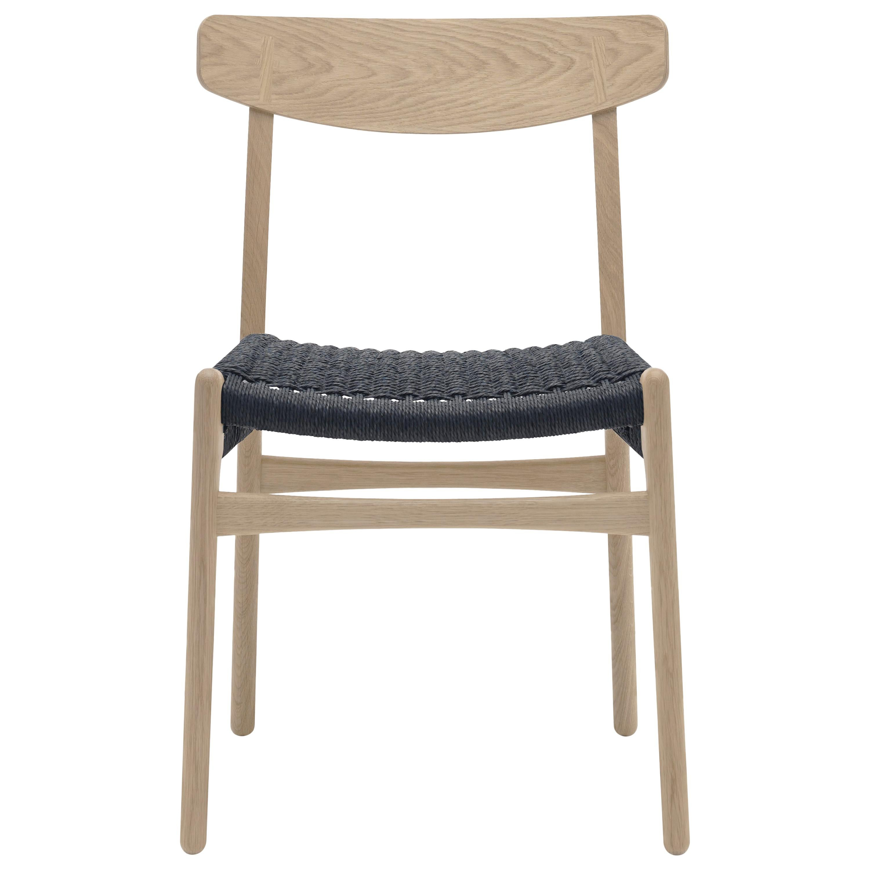 CH23 Dining Chair in Wood Finishes with Black Papercord Seat by Hans J. Wegner