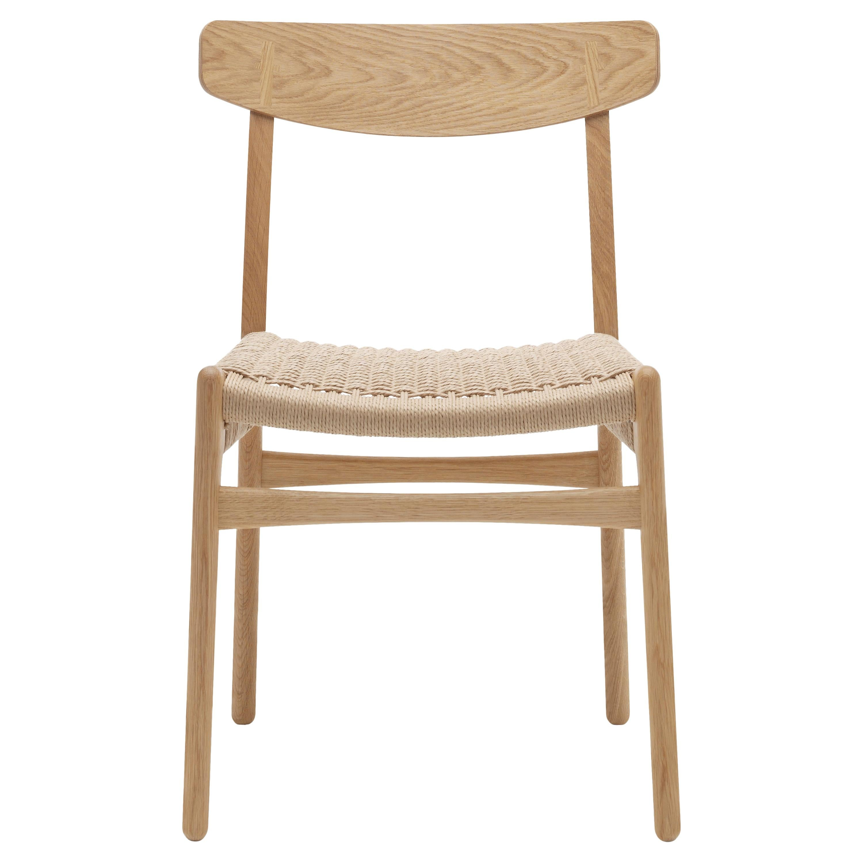 CH23 Dining Chair in Wood Finishes with Natural Papercord Seat by Hans J. Wegner