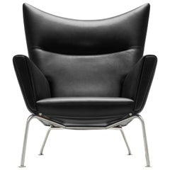CH445 Wing Chair in Leather with Stainless Steel Base by Hans J. Wegner