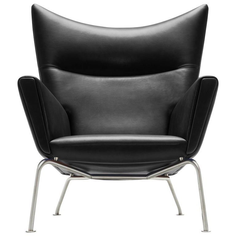 For Sale: Black (Thor 301) CH445 Wing Chair in Leather with Stainless Steel Base by Hans J. Wegner