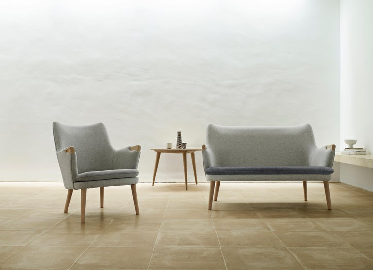 With its slender frame and flowing, sculptural form, Hans J. Wegner's CH71 lounge chair is a testament to the legendary Danish designer's unique understanding of woodworking and upholstery. Created in 1952, the design shows all the hallmarks of the