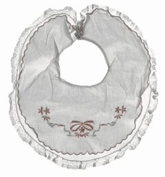 Aliboo Bib: Still Life Photograph of White & Pink Child's Embroidered Clothing