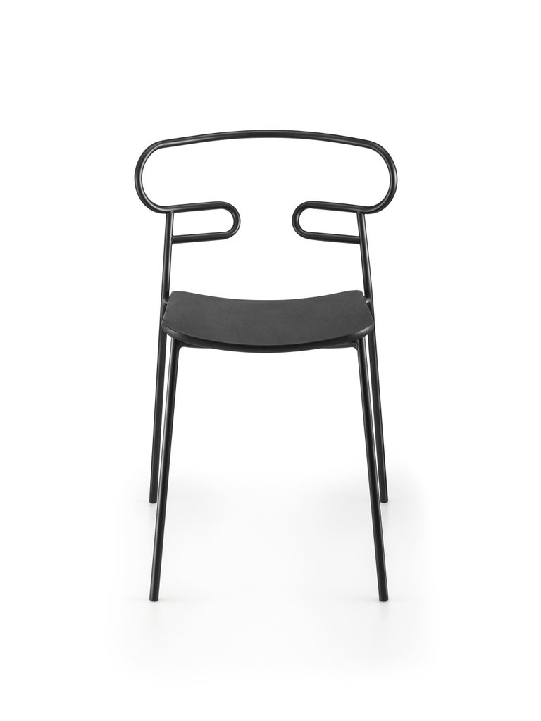 The Genoa chair collection, by talented young designer Cesare Ehr, featuring a stool and a chair with armrests, is also available in an outdoor version. The distinguishing element is the 'one-line' backrest, obtained by curving a single metal tube