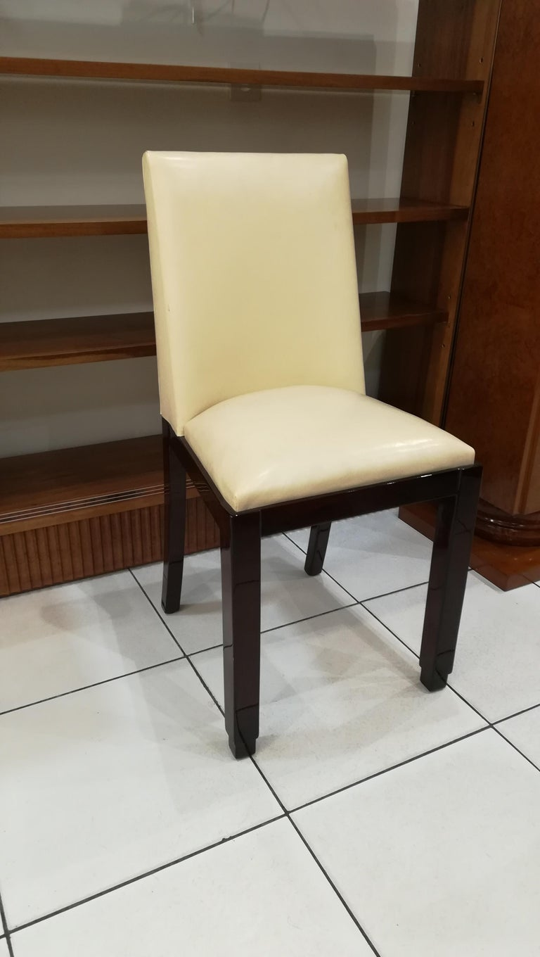 Art Deco chair, circa 1930, varnished wood and beige leather.
