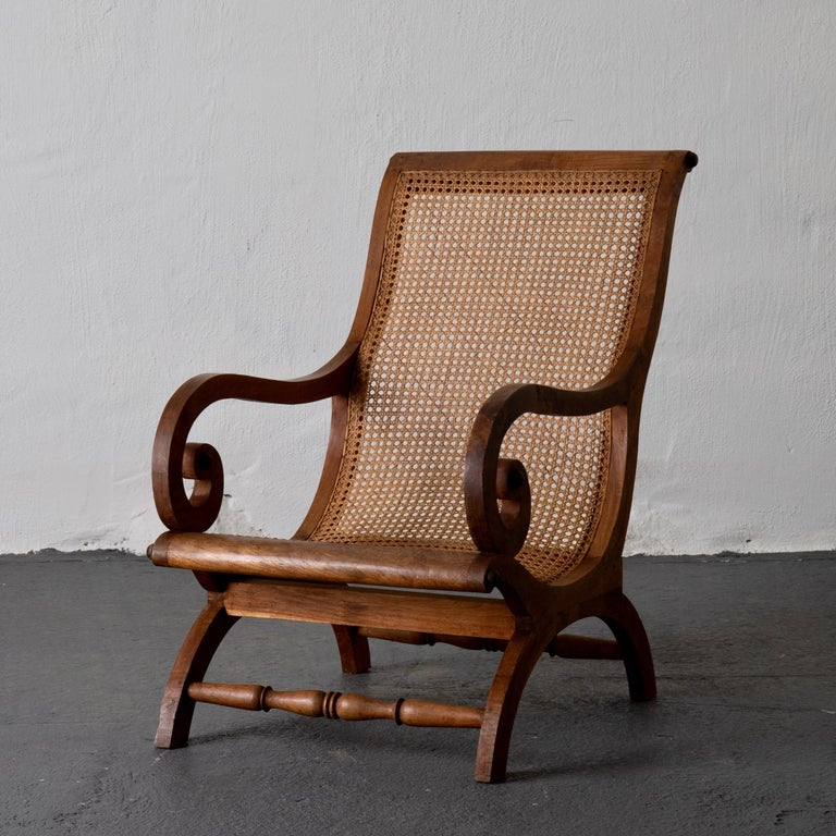 Chair lounge Swedish 20th century wood rattan, Sweden. A beautiful but relaxed armchair made during the mid-19th century in Sweden. Frame made from elm and seat from rattan.