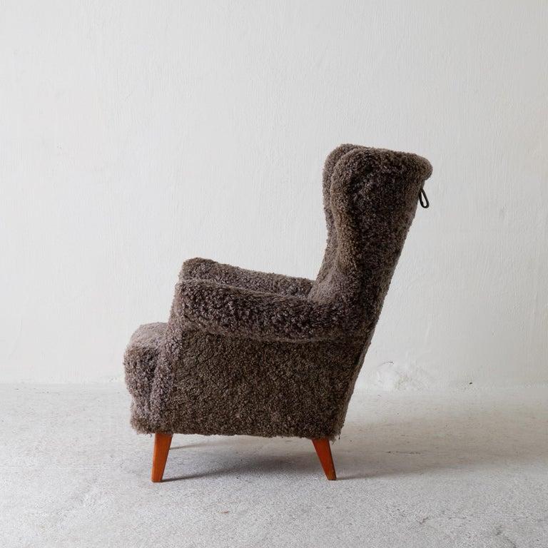 Chair lounge Swedish sheepskin grayish brown 20th century Sweden. An easy chair made during the 20th century in Sweden. Upholstered in a grayish-brown sheep skin.