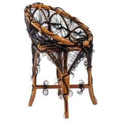 Chair of the Artist Micki Chomicki, Rattan and Synthetic Fiber