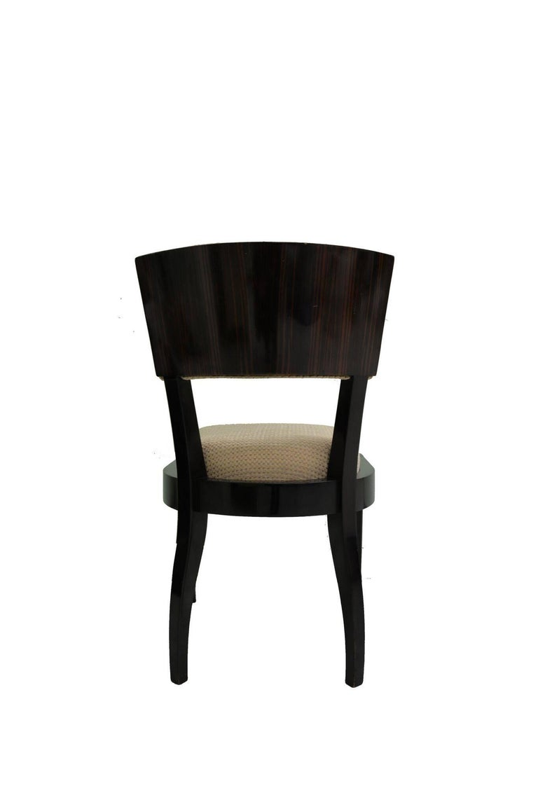 Six Art Deco dining chairs of Macassar ebony wood frame with beige fabric.