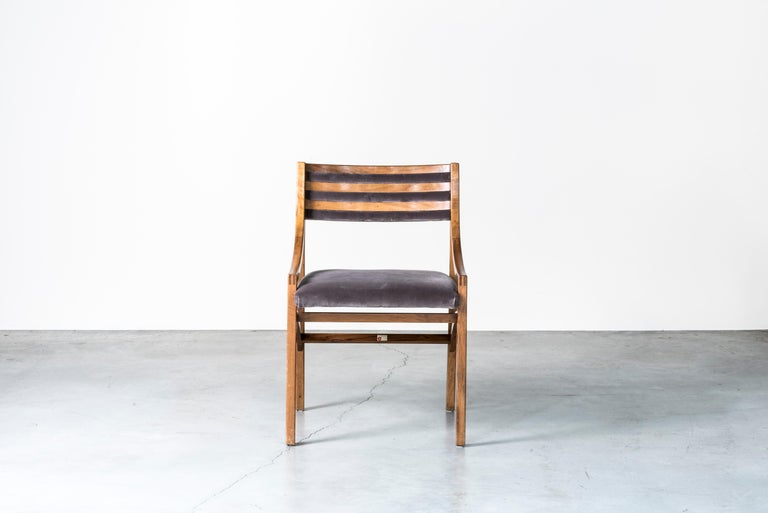 Eleven chairs mod. 110 by Ico Parisi. Italy, 1961. Manufactured by Figli di Amedeo Cassina, Meda. Mahogany wood, walnut wood, fabric upholstery. Measures: 59 x 51.5 x H 79 cm, H seat 47 cm, 23.2 x 20.2 x H 31.1 in, H seat 18.5. Literature: R.