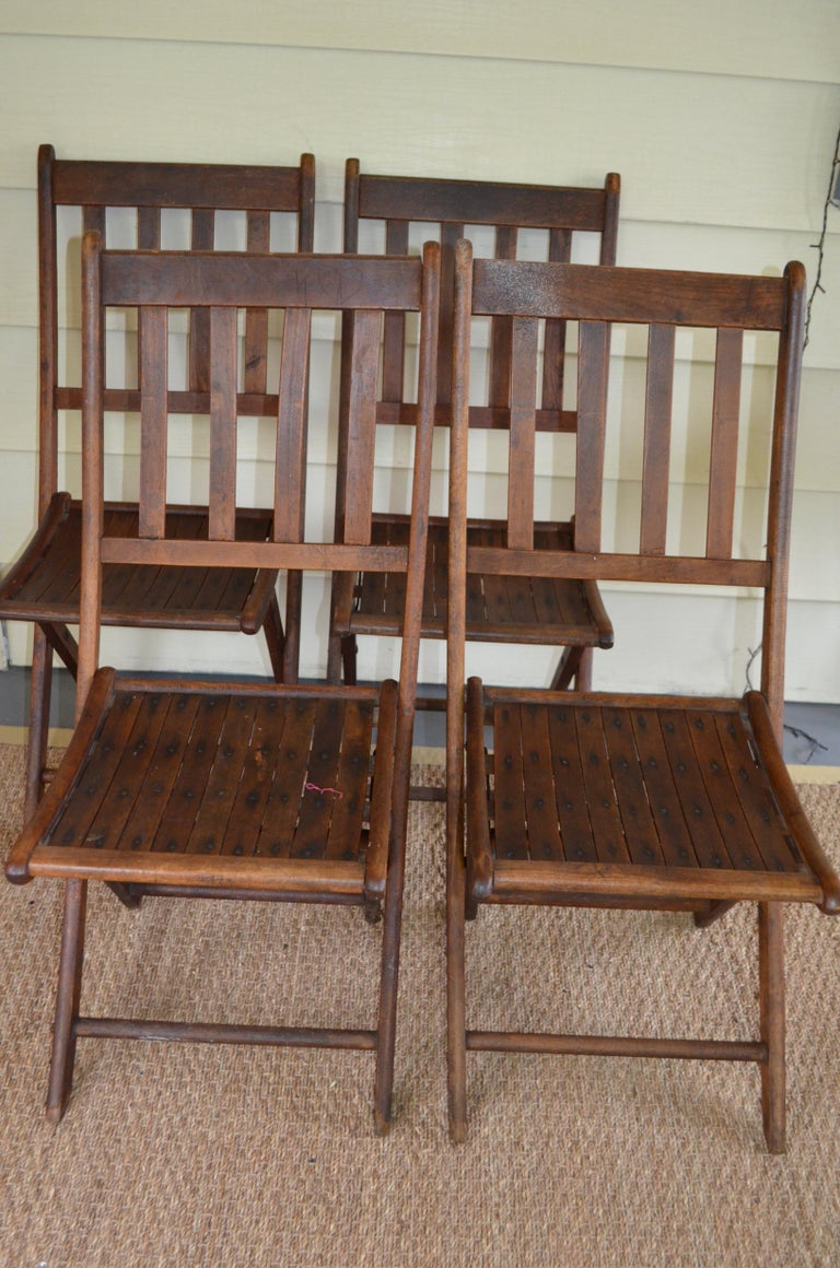Folding church-style chairs of oak that date to the 1890s, brought to the Midwest from across the pond as part of settlement into the new life of America. Clean-lined in their simplicity. People were smaller then, of course. These chairs will