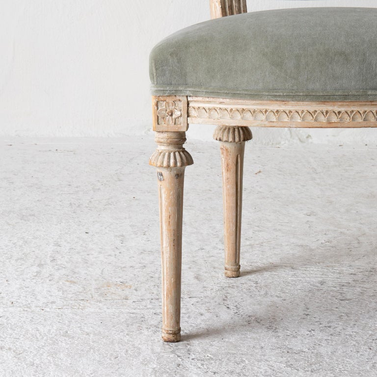 Chairs pair of side chairs Swedish Gustavian 1790-1810 velvet green beige white Sweden. Pair of side chairs made in Sweden during the Gustavian period 1790-1810. Upholstered seat and back in a faded green cotton velvet. Frame with carved details