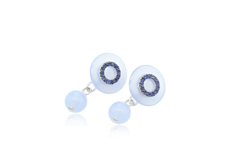 Handcrafted in Italy in Margherita Burgener workshop, this pair of cufflinks have a chain link it is unisex design.  18 KT white gold g 3,10  n.24  blue sapphires ct 0,30  natural chalcedony g 3,26 diameter of the frontal disk 1,5 cm - 3.81