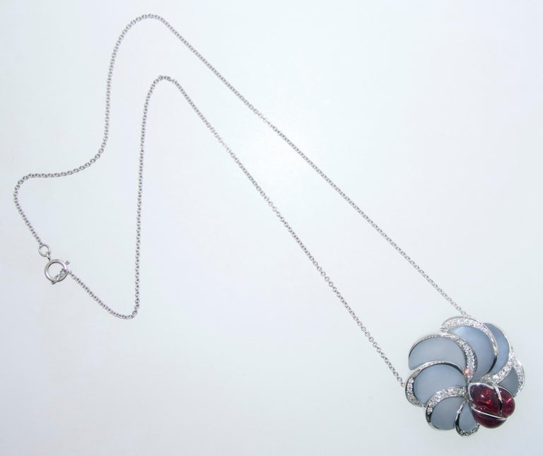 Floral motif pendant necklace made of frosted fancy cut natural light blue Chalcedony and fancy shape dark pink/red natural Rubellite (pink tourmaline), accented with 33 diamonds - all finely cut, well matched and near colorless (G/H) and very