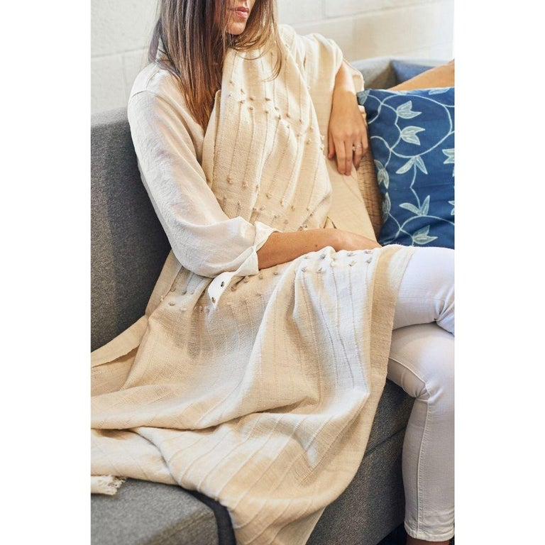 Custom design by Studio Variously, Chalk Throw is handwoven by master weavers in Nepal and dyed entirely with earth friendly dyes in soft 100% merino yarn that is hand spun.  A sustainable design brand based out of Michigan, Studio Variously