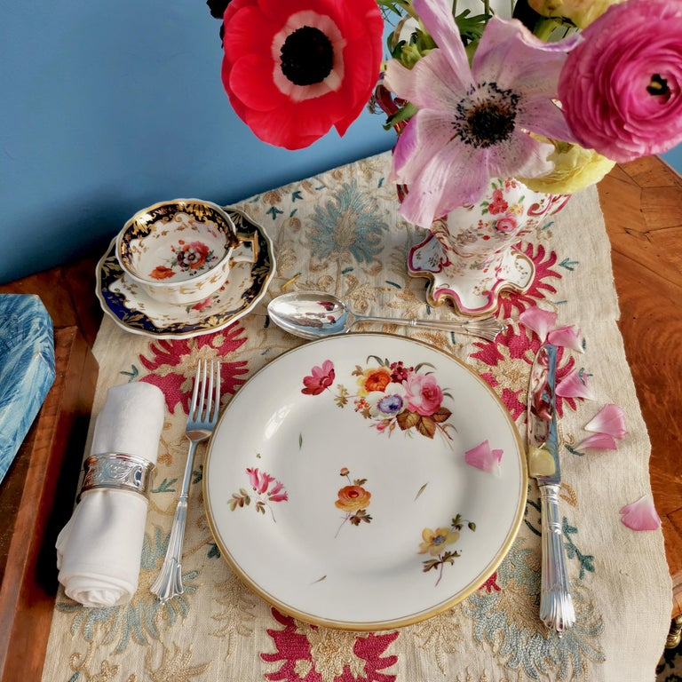 This is a dessert plate made by Chamberlain's Worcester between 1846 and 1850. The plate is decorated with sublimely painted flowers.  The Chamberlain factory was founded in the 1780s by Robert Chamberlain, who was responsible for the decoration