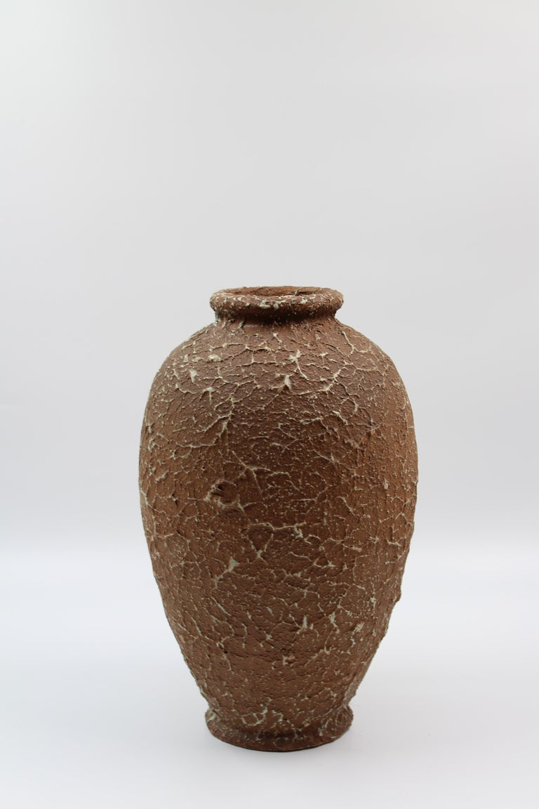 A ceramic vase, made with the chamotte technique, by the Swedish company Andersson & Johansson at Höganäs Keramik. The stamp dates the vase to between 1920 and 1958. Beautiful and very decorative object in very good vintage condition.