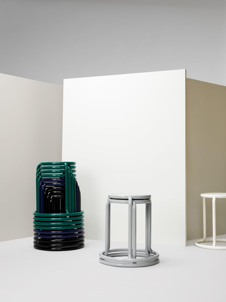 Champ is a reimagining of the utilitarian stackable stool. When stored, the stools form a graceful and graphic upward spiral. Taking cues from the original champ stool, the collection has grown to include a counter height stool, barstool and cafe