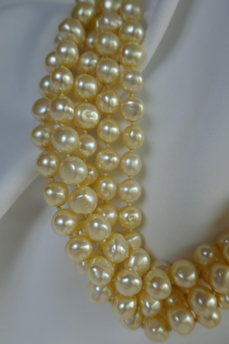This is a five strand champagne (pale Yellow) cultured nugget pearl necklace with a 925 sterling silver clasp. The cultured nugget pearls are 10.5mm-11mm. The pearls have great luster and very little blemishes. It is strung on silk thread and