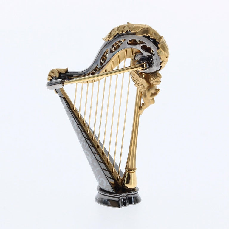 Mousson Atelier represent with prouds! 18 Karat Gold High detailing Harp brooch. Champagne Diamonds, all strings are tighten by hand.  Small angel on the deck and Greek style leaf ornament on it, gives antic look.  40mm x 27mm x 10mm 8.52 gms