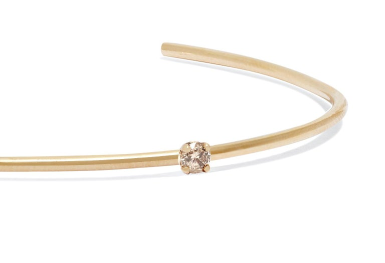Clean-lined and elegant, this solid 18-carat yellow gold cuff features a champagne diamond set to sparkle at the wrist bone.  Diamond measures approximately 3 mm; 0.06 total carat weight.   Handmade in London. Hallmarked 750 Allison Bryan London.