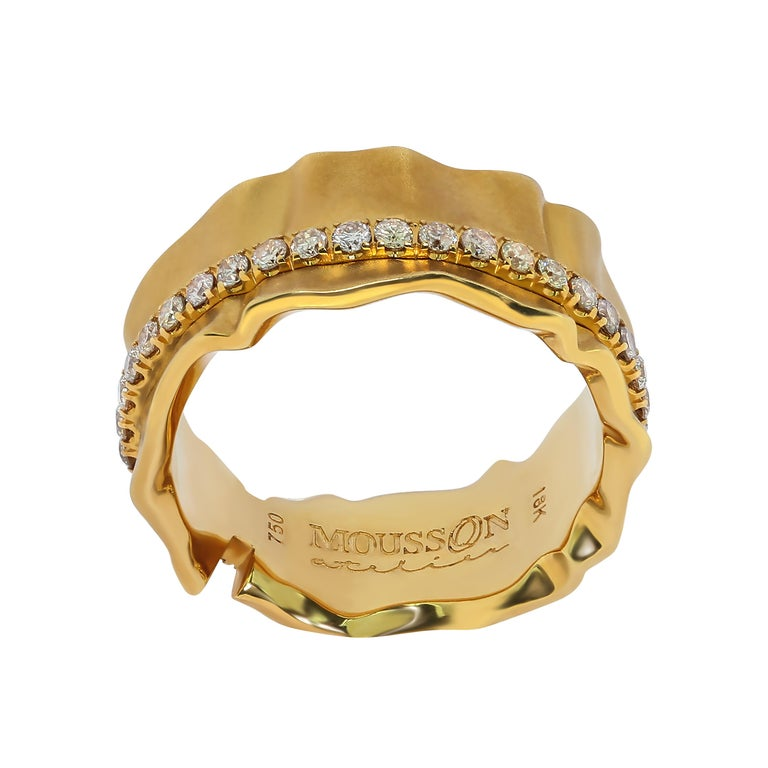 Champagne Diamonds 18 Karat Yellow Gold Pret-a-Porter Ring Rings from Pret-a-Porter collection are the elegance of fabrics. This Ring is made as if of silk, which is pretty crumpled under the pressure of shiny 38 Champagne Diamonds.