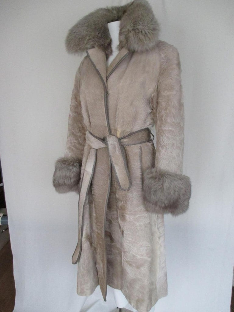 Amazing vintage coat from pony skin with fox fur collar and cuffs.  With 2 pockets, 3 closing hooks, fully lined, leather trimmed and a matching belt. Good preloved condition, with little signs of use. Rare to find. Size is about small, see section