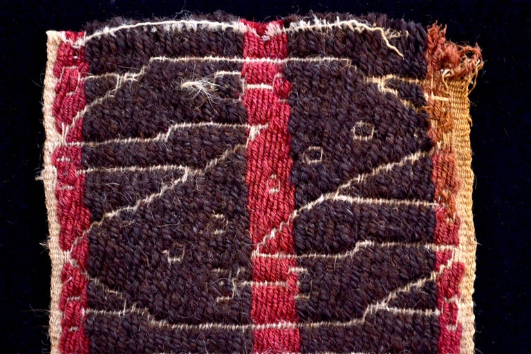 Magnificent Brown and red striped textile fragment with creme Z shaped patterns.  It is a wonder to behold antiquities such as a pre-columbian textiles, an authenticpiece of art that has been preserved for centuries and that survives generation