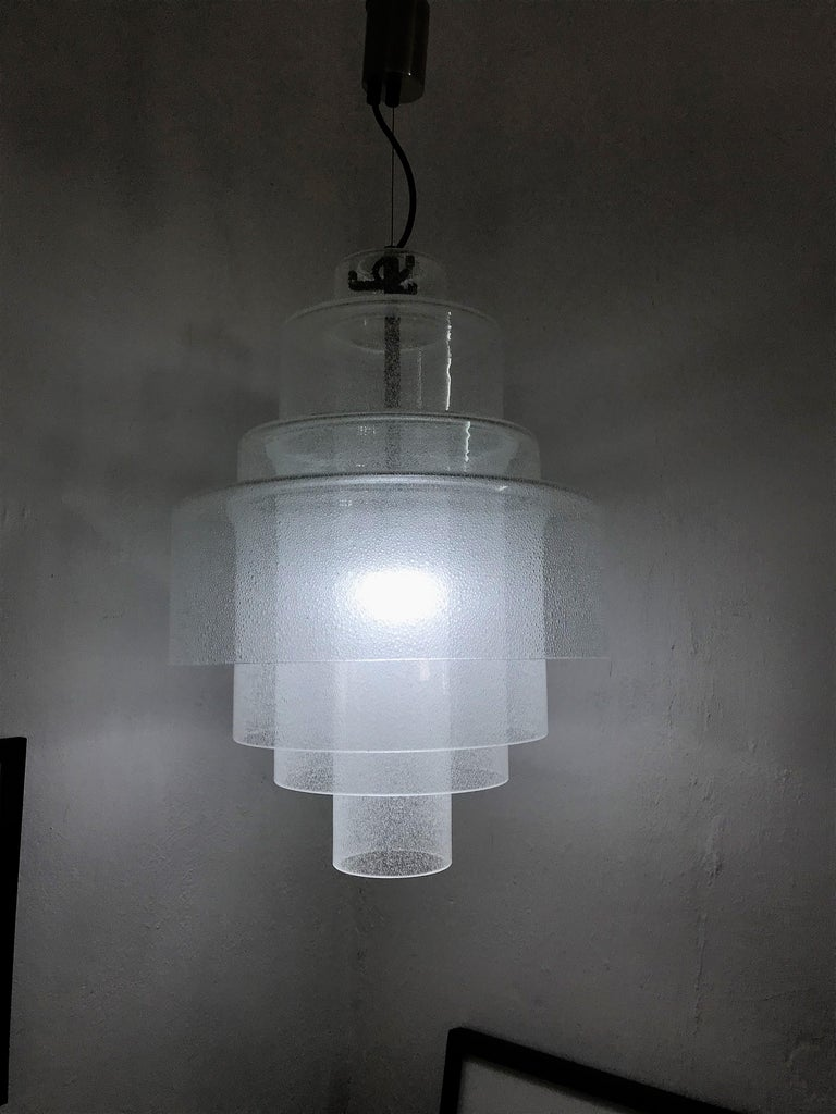 Beautiful and rare Mid-Century Modern chandelier pendant lamp by Mazzega, designed by Carlo Nason, circa 1960, Murano, Italy. The lamp alone measures 21 inches tall and has a 15 inch diameter This chandelier is the Large version as it consists of