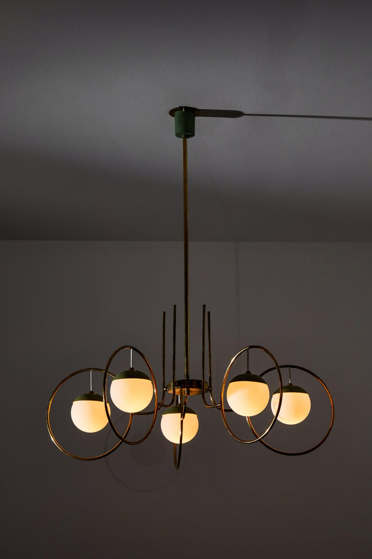 Chandelier by Stilnovo. Manufactured in Italy, circa 1950s. Brushed satin glass diffusers, brass, original enameled aluminum. Custom brass ceiling plate. Original canopy. Rewired for U.S. standards. We recommend five E27 40w maximum bulbs. Bulbs