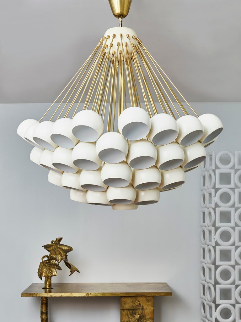 Important chandelier in brass with lacquered sheet metal globes.  Creation by Studio Glustin.