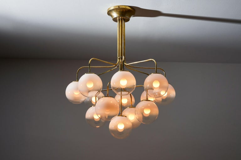 Thirteen globe chandelier by Angelo Mangiarotti for Candle. Designed and manufactured in Italy, circa 1960s. Brass with hand blown two-toned opaque Murano globes. Rewired for US junction boxes. Each globe takes one E27 25w maximum bulbs. Bulbs