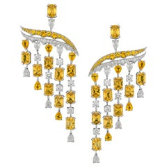 Chandelier Earrings crafted in 18K White Gold, White Diamonds, Yellow Sapphires