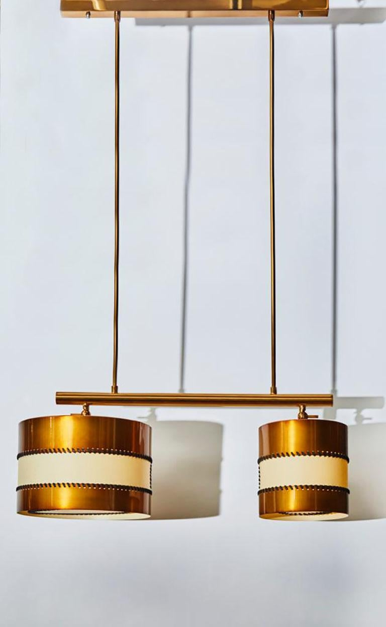New design by Diego Mardegan exclusively for Glustin Luminaires, Dedalo chandelier made of two brass and parchment paper drums that can be adjusted invidually. Hung by a pure and simple structure in this beautiful patina between bronze and copper.