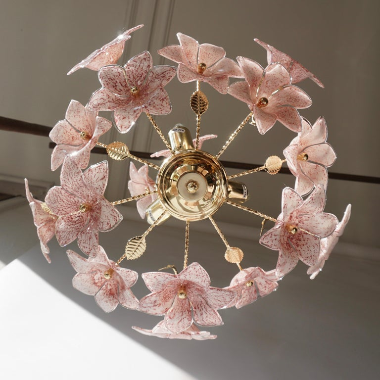 Italian brass chandelier with pink Murano glass flowers and brass leaves. 